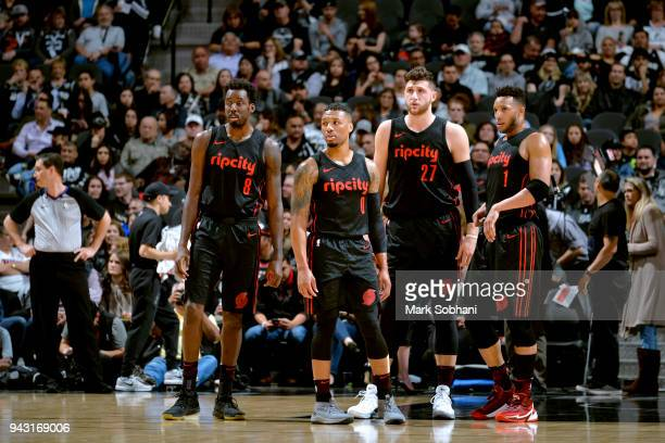 AlFarouq Aminu Damian Lillard Jusuf Nurkic and Evan Turner of the Portland Trail Blazers look on during the game against the San Antonio Spurs on...