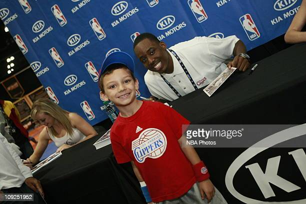 Al-Farouq Aminu of the LA Clippers signs autographs and poses with a fan during an autograph session in the Kia MVP Cout at Jam Session presented by...