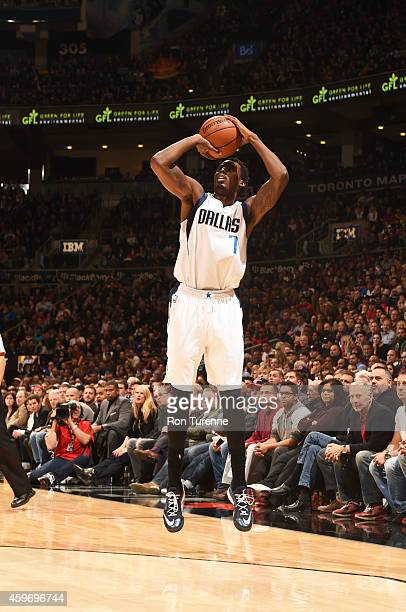 AlFarouq Aminu of the Dallas Mavericks shoots the ball against the Toronto Raptors during the game on November 28 2014 at the Air Canada Centre in...