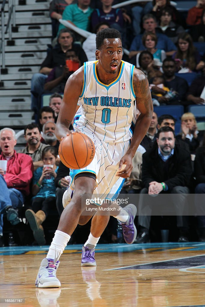 Al-Farouq Aminu #0 of the New Orleans Hornets brings the ball up court against the Denver Nuggets on March 25, 2013 at the New Orleans Arena in New Orleans, Louisiana.