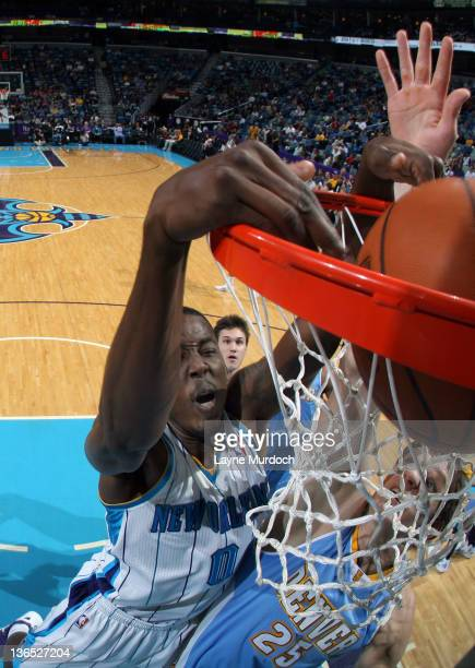 AlFarouq Aminu of the New Orleans Hornets dunks the ball during an NBA game between the Denver Nuggets and the New Orleans Hornets on January 6 2012...