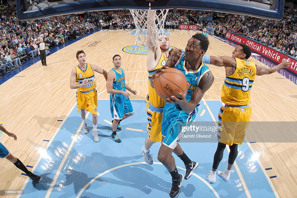 Al-Farouq Aminu #0 of the New Orleans Hornets goes to the basket during the game between the New Orleans Hornets and the Denver Nuggets on November 25, 2012 at the Pepsi Center in Denver, Colorado.