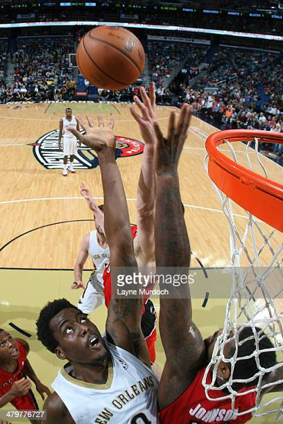 AlFarouq Aminu of the New Orleans Pelicans shoots against the Toronto Raptors on March 19 2014 at the Smoothie King Center in New Orleans Louisiana...