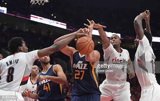 AlFarouq Aminu of the Portland Trail Blazers blocks the shot of Rudy Gobert of the Utah Jazz as Maurice Harkless and Ed Davis of the Portland Trail...