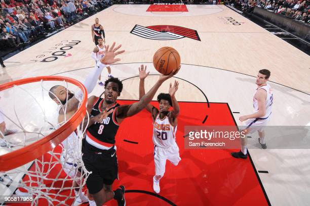 AlFarouq Aminu of the Portland Trail Blazers dunks against Josh Jackson of the Phoenix Suns on January 16 2018 at the Moda Center in Portland Oregon...
