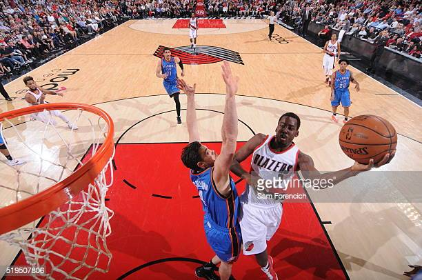 AlFarouq Aminu of the Portland Trail Blazers goes for the layup against the Oklahoma City Thunder during the game on April 6 2016 at Moda Center in...