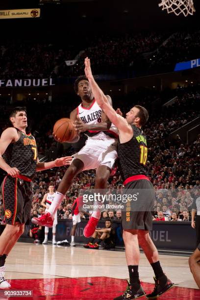 AlFarouq Aminu of the Portland Trail Blazers goes to the basket against the Atlanta Hawks on January 5 2018 at the Moda Center Arena in Portland...