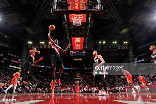 AlFarouq Aminu of the Portland Trail Blazers grabs the rebound against the Houston Rockets on January 10 2018 at the Toyota Center in Houston Texas...