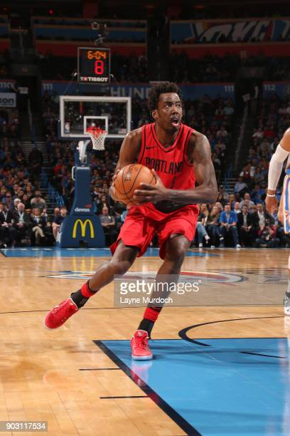 AlFarouq Aminu of the Portland Trail Blazers handles the ball against the Oklahoma City Thunder on January 9 2018 at Chesapeake Energy Arena in...