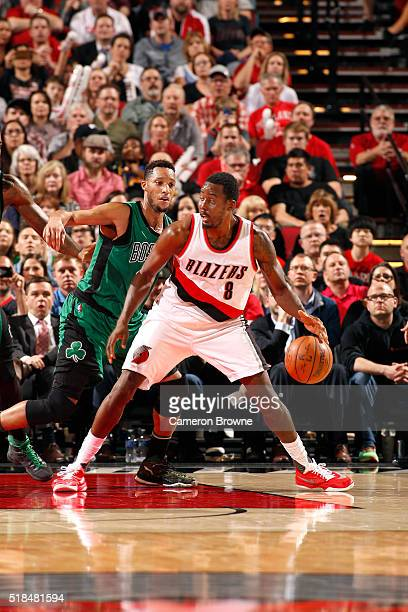 AlFarouq Aminu of the Portland Trail Blazers handles the ball during the game against the Boston Celtics on March 31 2016 at the Moda Center in...