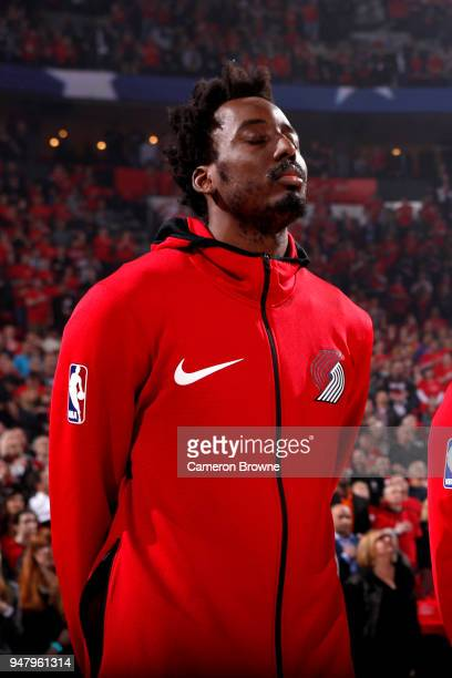 AlFarouq Aminu of the Portland Trail Blazers honors the National Anthem before the game against the New Orleans Pelicans in Game Two of Round One of...