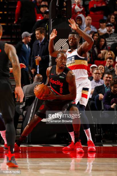 AlFarouq Aminu of the Portland Trail Blazers jocks for a position during the game against Julius Randle of the New Orleans Pelicans on January 18...