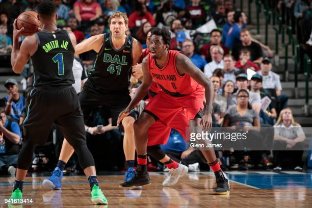 AlFarouq Aminu of the Portland Trail Blazers plays defense against Dirk Nowitzki of the Dallas Mavericks on April 3 2018 at the American Airlines...