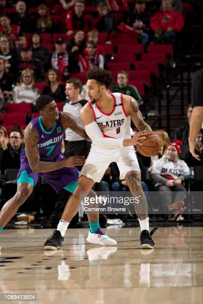 AlFarouq Aminu of the Portland Trail Blazers posts up against Dwayne Bacon of the Charlotte Hornets on January 11 2019 at the Moda Center Arena in...