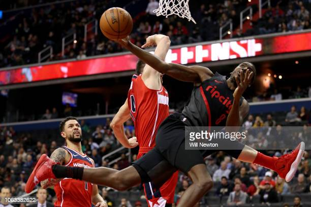 AlFarouq Aminu of the Portland Trail Blazers shoots against Jason Smith of the Washington Wizards during the second half at Capital One Arena on...