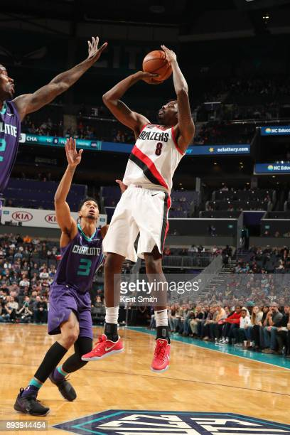 AlFarouq Aminu of the Portland Trail Blazers shoots the ball against the Charlotte Hornets on December 16 2017 at Spectrum Center in Charlotte North...