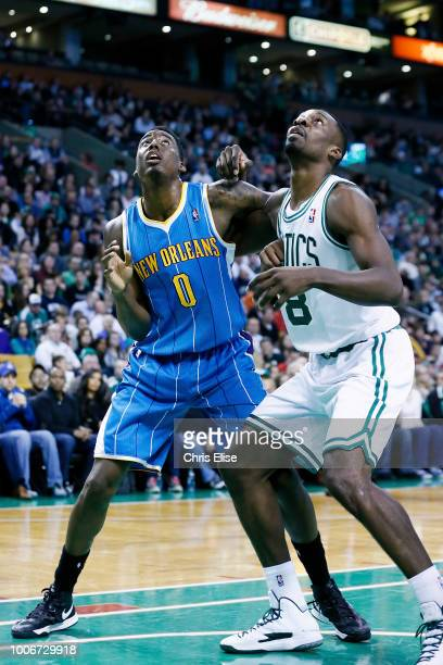 AlFarouqAminu of the New Orleans Hornets and Jeff Green of the Boston Celtics vie for the rebound on January 16 2013 at the Staples Center in Los...