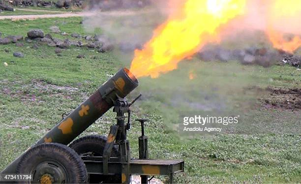 AlFatah forces members fire artillery a domestic gas bottle turned into a weapon nicknamed 'hell' during they clash with Syrian regime forces' in the...