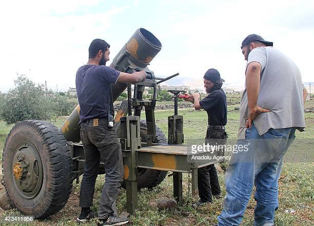 AlFatah forces members load artillery with a domestic gas bottle turned into a weapon nicknamed 'hell' before they attack on Syrian regime forces' in...