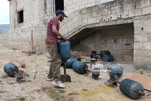 AlFatah forces members prepare artillery a domestic gas bottle turned into a weapon nicknamed 'hell' before they attack on Syrian regime forces' in...