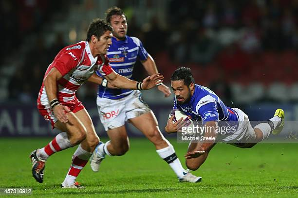 Alfi Mafi of Brive hits the ground as James Hook of Gloucester closes in during the European Rugby Challenge Cup Pool 5 match between Gloucester...