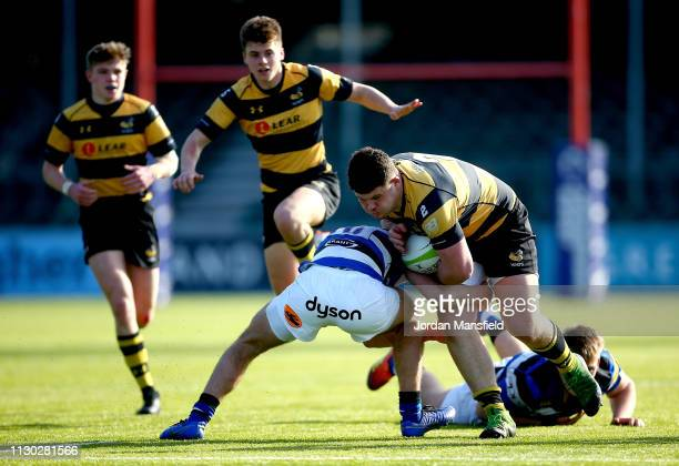 Alfie Barbeary of Bath u18's tackled by Orlando Bailey of Wasps u18's during the 3/4th Place Playoff match between Bath U18's and Wasps U18's during...