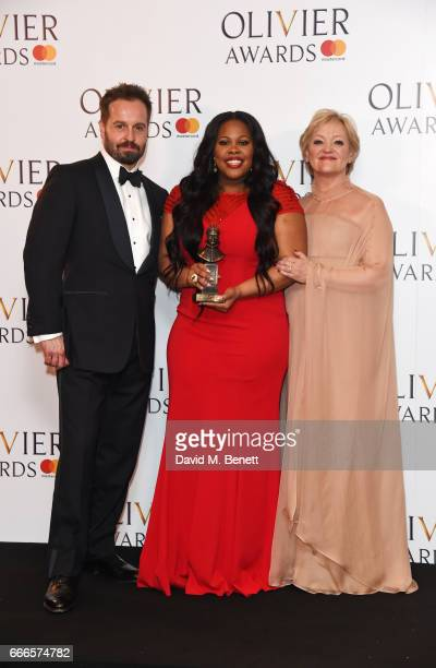 Alfie Boe Amber Riley winner of the Best Actress In A Musical award for 'Dreamgirls' and Maria Friedman pose in the winners room at The Olivier...