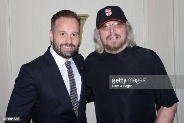 Alfie Boe and Barry Gibb pose during the Nordoff Robbins' O2 Silver Clef Awards ceremony at Grosvenor House on July 6 2018 in London England