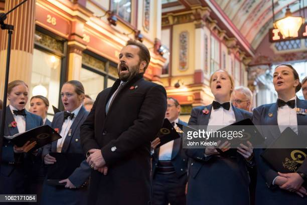 Alfie Boe performs with the Royal Airforce Spitfire choir in support of London Poppy Day at Leadenhall Market on November 01 2018 in London England...