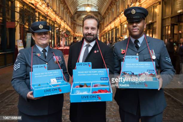 Alfie Boe poses members of the armed forces in support of London Poppy Day at Leadenhall Market on November 01 2018 in London England Around 2000...