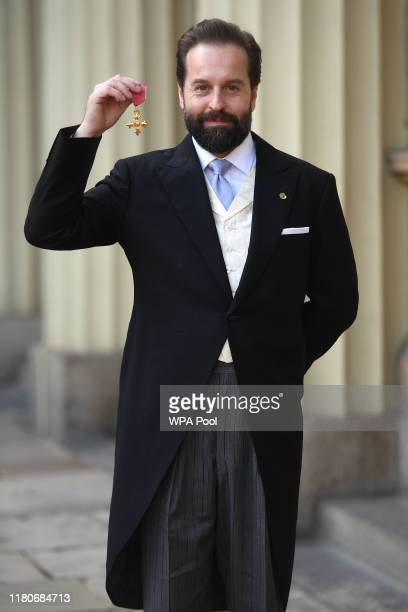 Alfie Boe poses with his OBE medal presented by the Prince of Wales during an investiture ceremony at Buckingham Palace on November 7 2019 in London...