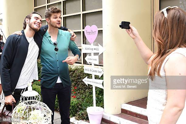 Alfie Deyes and Jim Chapman attend the Tanya Burr Cosmetics New Beauty Collection Launch Party at Kensington Roof Gardens on August 20 2015 in London...