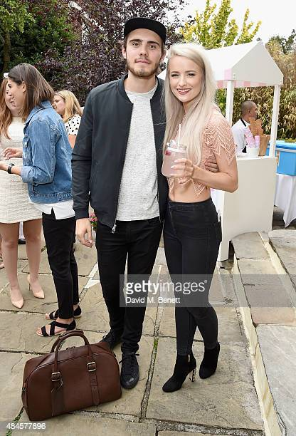 Alfie Deyes and Victoria Magrath attends the Tanya Burr Cosmetics New Beauty Collection Launch Party at Kensington Roof Gardens on August 20 2015 in...