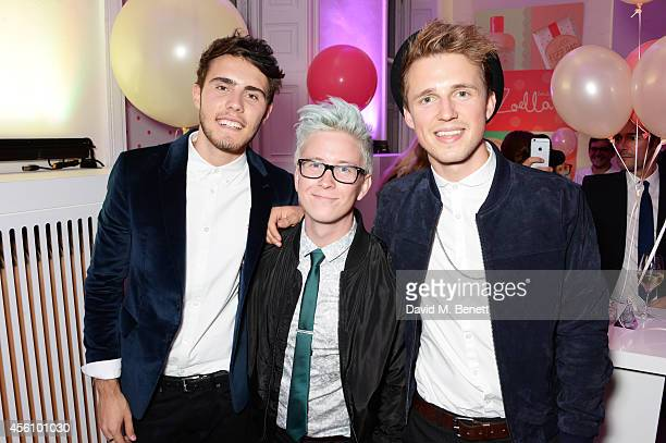 Alfie Deyes Tyler Oakley and Marcus Butler attend YouTube phenomenon Zoe Sugg's launch of her debut beauty collection at 41 Portland Place on...