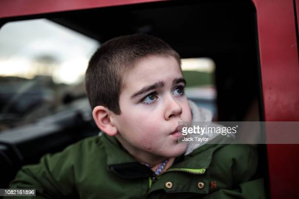Alfie Dingley takes his cannabis oil medicine as he sits in a car at Kenilworth Castle on January 13, 2019 in Kenilworth, England. Alfie Dingley,...