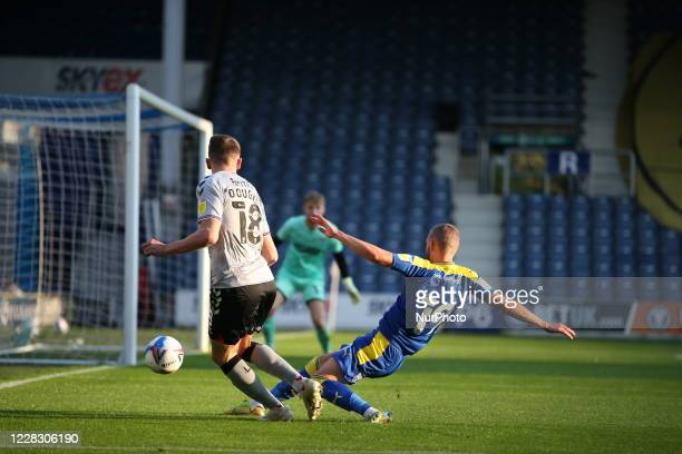 LONDON ENGLAND SEPT 1ST 2020 Alfie Doughty of Charlton Athletic crosses the ball into the box during the EFL Trophy match between AFC Wimbledon and...