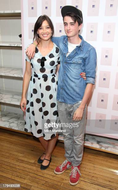 Alfie Goffey and Daisy Lowe attend as Alexa Chung celebrates the launch of her first book It at Liberty on September 4 2013 in London England