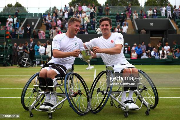 Alfie Hewett and Gordon Reid of Great Britain celebrate with the trophy after winning their men's doubles wheel chair tennis final against Stephane...