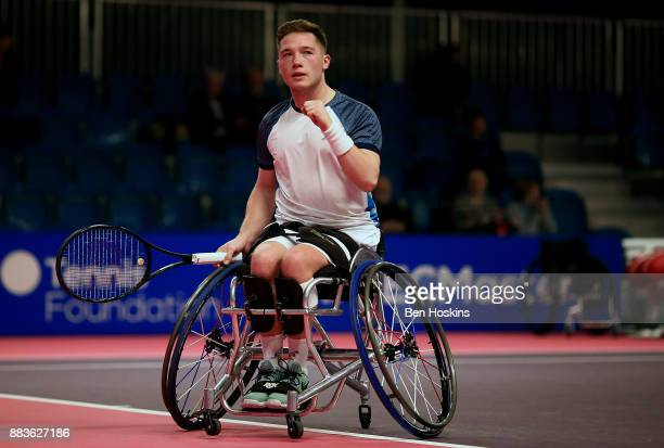 Alfie Hewett of Great Britain celebrates winning a point during his match against Stephane Houdet of France on day 3 of The NEC Wheelchair Tennis...