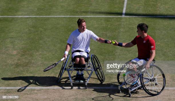 Alfie Hewett of Great Britain celebrates with Gordon Reid in the men's wheelchair doubles against Stephane Houdet and Nicolas Peifer of France during...