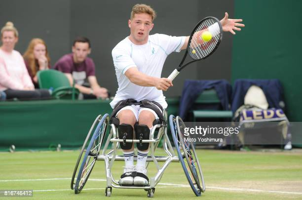 Alfie Hewett of Great Britain plays a backhand during the Gentlemen's wheel chair doubles final against Stephane Houdet and Nicolas Peifer of France...