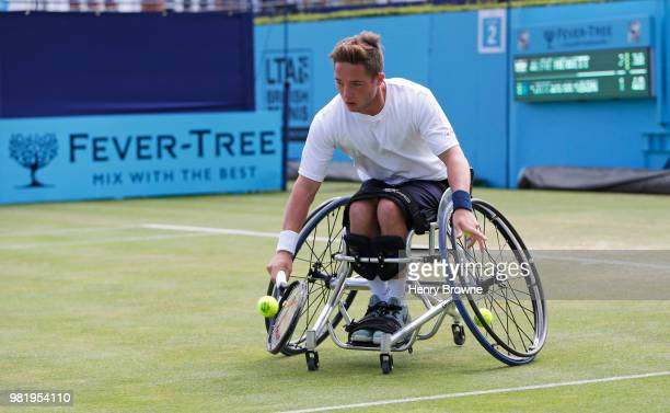 Alfie Hewett of Great Britain plays a backhand during the men's wheelchair match against Stefan Olsson of Sweden during Day 6 of the FeverTree...