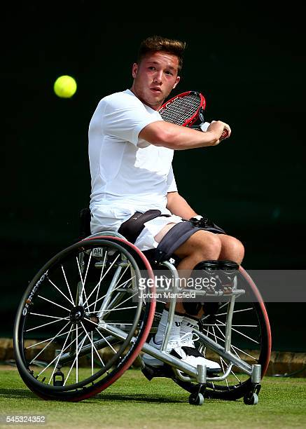 Alfie Hewett of Great britain plays a backhand during the Men's Wheelchair Singles against Joachim Gerard of Belgium on day ten of the Wimbledon Lawn...