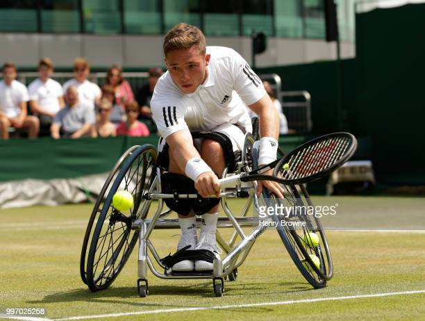 Alfie Hewett of Great Britain plays a shot during the mens wheelchair quarter final against Stephane Houdet of France at the All England Lawn Tennis...