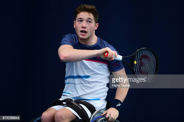 Alfie Hewett of Great Britain reacts after hitting the ball during Day Three of the Bath Indoor Wheelchair Tennis Tournament at the University of...