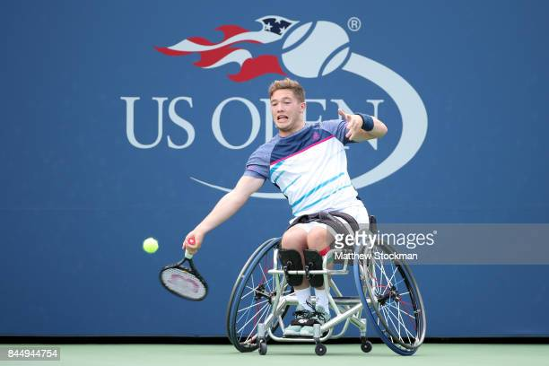 Alfie Hewett of Great Britain returns a shot against Gordon Reid of Great Britain in their Wheelchair Men's Singles semifinal match on Day Thirteen...