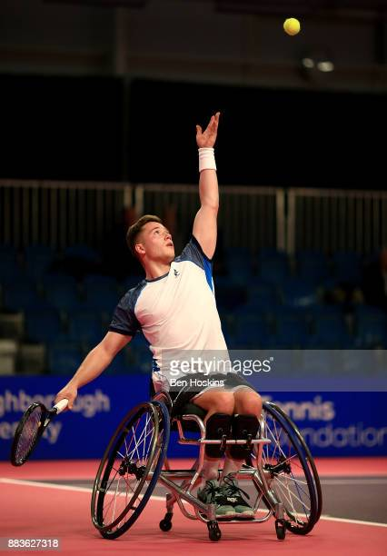 Alfie Hewett of Great Britain serves during his match against Stephane Houdet of France on day 3 of The NEC Wheelchair Tennis Masters at Loughborough...