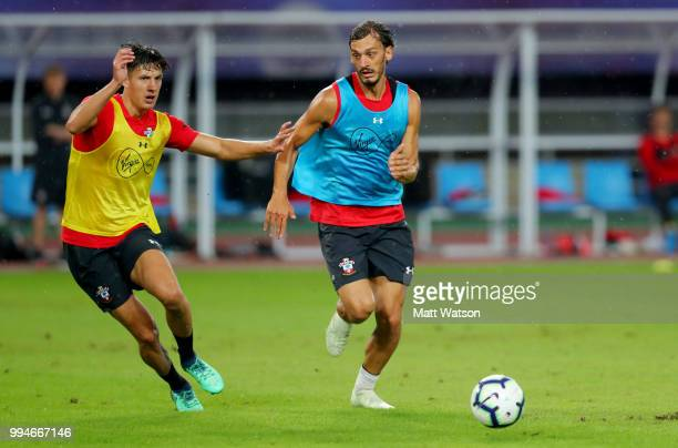 Alfie Jones and Manolo Gabbiadini during a Southampton FC training session while on their pre season tour of China on July 9 2018 in Xuzhou China