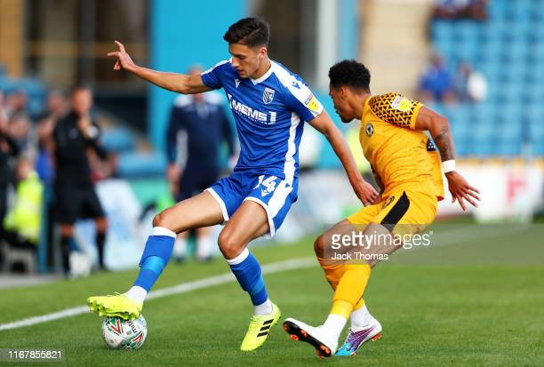 Alfie Jones of Gillingham FC is challenged by Corey Whitely of Newport County during the Carabao Cup First Round match between Gillingham and Newport...