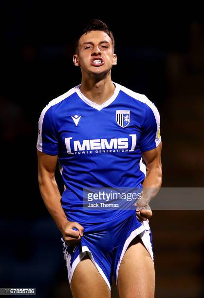 Alfie Jones of Gillingham FC reacts after missing his team's first penalty in the penalty shoot out during the Carabao Cup First Round match between...
